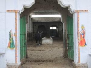 View of a cow shed with Gopis on the walls, it is customary to have gopis around Shreeji