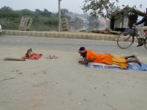 A Sadhu doing the Govardhan Parikrama by Dandvat. He will prostrate at each step and continue this all through the Parikrama